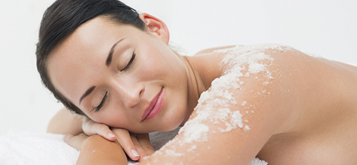 Salt therapy - woman taking salt massage session